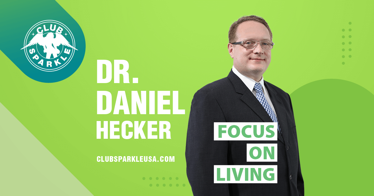 An image of Doctor Daniel Hecker wearing a black suit and white shirt with a blue tie with the words Focus on Living superimposed over him.